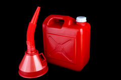 Red Plastic Fuel Can and Funnel on a Black Background Stock Image