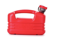 Red plastic fuel canister in hand Royalty Free Stock Photos