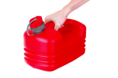 Red plastic fuel canister in hand isolated Stock Image