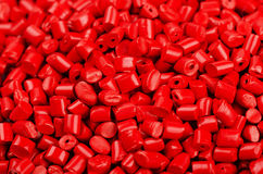 Red plastic grains Royalty Free Stock Photography