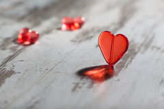 Red plastic heart on a white board Royalty Free Stock Photos