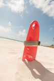 Red plastic life guard tube, on the beach. Royalty Free Stock Image
