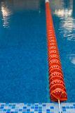 Red plastic line in swimming pool Royalty Free Stock Photo