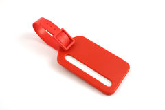 Red plastic luggage label Royalty Free Stock Photography