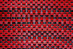 Red plastic mats pattern. Red plastic woven mats pattern background, Texture, Closeup, Thailand Stock Photo
