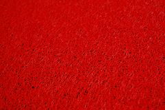 Red plastic napkin texture up close Royalty Free Stock Photo