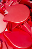 Red plastic objects. Piled into a box Royalty Free Stock Images