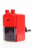 Red plastic pencil sharpener Royalty Free Stock Image