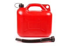Red plastic petrol canister. Isolated on the white background stock photography