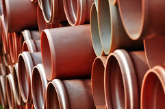 Red plastic pipes. Stacked in a pile Stock Images