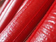 Red plastic pipes. For thermoisolation royalty free stock image