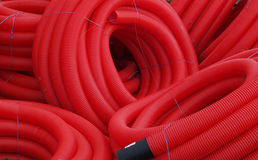 Red plastic pipes. Used for construction Stock Image
