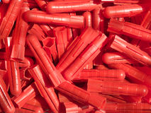 Red plastic plugs Stock Photo