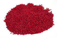 Red plastic polymer granules. On white background Royalty Free Stock Photography