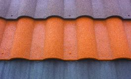 Red plastic roof tiles home Royalty Free Stock Image