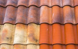 Red plastic roof tiles home Stock Photo