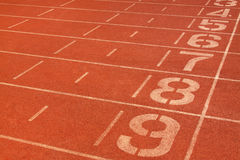 Red plastic runway and numbers in a sports ground, in Beijing, C Royalty Free Stock Photos