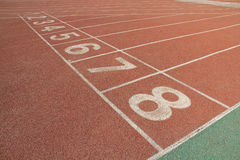 Red plastic runway in a sports ground Royalty Free Stock Photography