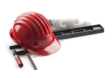 Hard hat and tools Stock Photos