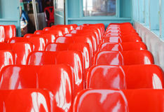 Red plastic seat Stock Images