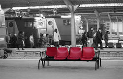 Red plastic seats on busy railway station platform. Red plastic seats on some of the Bucharest North Railway Station platform. Bucharest North Railway Station is royalty free stock images