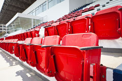 Red plastic seats in empty stadium Royalty Free Stock Photography