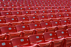 Red plastic seats, front Stock Photo