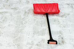 Red plastic shovel for snow removal. Winter is coming Royalty Free Stock Image