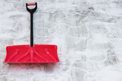 Red plastic shovel for snow removal. Winter is coming Stock Photography