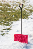Red plastic shovel for snow removal. Royalty Free Stock Photos