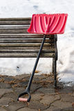 Red plastic shovel for snow removal. Winter is coming Stock Photos