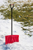 Red plastic shovel for snow removal. Winter is coming Royalty Free Stock Photography