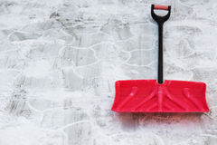 Red plastic shovel for snow removal. Winter is coming Royalty Free Stock Photo
