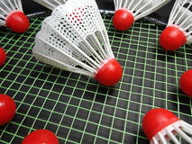 Red plastic shuttlecocks on badminton racket Royalty Free Stock Photos