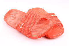 Red plastic slippers Stock Images