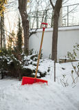 Red plastic snow shovel. Stock Images