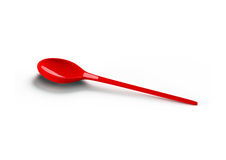 Red plastic spoon Stock Image