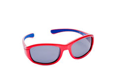 Red plastic sport sunglasses on white. Background stock images