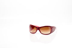 Red plastic sun glasses with brown lens Stock Image