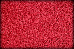Red plastic swimming pool mat surface Royalty Free Stock Photography