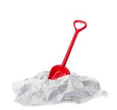 Red plastic toy shovel in paper Royalty Free Stock Image