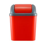 Red plastic trash can on white. Background Stock Photo