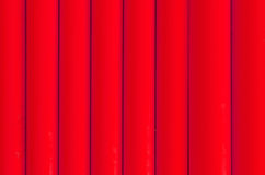 Red plastic tubing pattern texture background Royalty Free Stock Photo