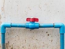 Red plastic valve. Stock Photography