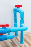 Red plastic valve on the PVC pipe Stock Images