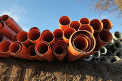Red plastic water pipes Royalty Free Stock Photography