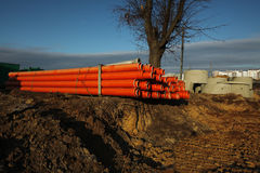 Red plastic water pipes Royalty Free Stock Photos