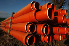 Red plastic water pipes Royalty Free Stock Image