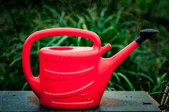 Red plastic watering can Royalty Free Stock Photo