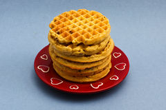 Red plate with blueberry wafles Stock Photography